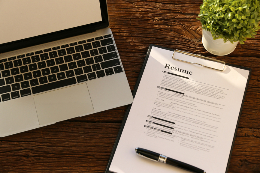 resume writing tips advice livecareer with pen laptop levels of skills on business Resume Advice With Resume Writing